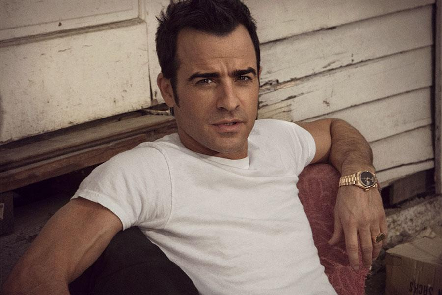Justin Theroux wearing his yellow gold Rolex Day_Date President with a black dial